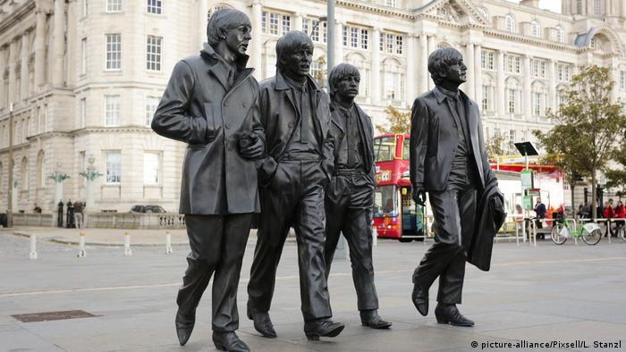 Black statues of the four Beatles in Liverpool
