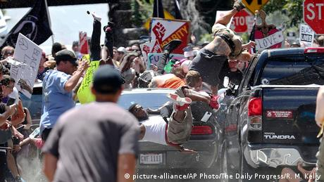 People go flying as vehicle plows into protesters in Charlottesville, VA (picture-alliance/AP Photo/The Daily Progress/R. M. Kelly)