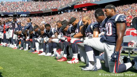 New England Patriots players taking a knee (Getty Images/J. Rogash)