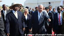 Israeli Prime Minister, Benjamin Netanyahu, right, is greeted by Ugandan President, Yoweri Museveni, on this arrival in at Entebbe airport Uganda, Monday, July 4, 2016. Netanyahu is on a four-nation Africa tour of Uganda, Kenya, Rwanda and Ethiopia. (AP Photo/Stephen Wandera) |
