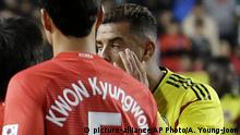 In this Friday, Nov. 10, 2017, photo, Colombia's Edwin Cardona, center, makes derogatory gesture during a friendly soccer match against South Korea at Suwon World Cup Stadium in Suwon, south of Seoul. Cardona has apologized after sparking a racism controversy during his team's 2-0 loss to South Korea in the international friendly. (AP Photo/Ahn Young-joon)  