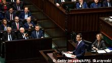 Incoming Polish Prime Minister Mateusz Morawiecki gives a speech to present his programme to lawmakers on December 12, 2017