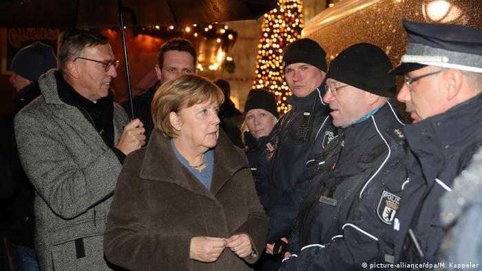 Angela Merkel makes surprise visit to site of Berlin Christmas market attack