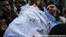 December 12, 2017 - Gaza City, The Gaza Strip, Palestine - Palestinian mourners carry the body of a Palestinian Islamic Jihad militant during his funeral following a reported Israeli strike in Beit Lahia in the northern Gaza Strip on December 12, 2017 |