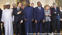 13.12.2017 *** From left, Mali'sPresident Ibrahim BoubacarKeita, France's President Emmanuel Macron, Chad's President Idriss Deby, Niger's President Mahamadou Issoufou, German Chancellor Angela Merkel and Italy's Prime Minister Paolo Gentiloni pose for a group photo during conference to support the fight against Jihadist in the African Sahel region at the Chateau of the La Celle Saint-Cloud, west of Paris, France, Wednesday, Dec. 13, 2017. Presidents, princes and diplomats are in France to breathe life into a young African military force that aims to counter the growing Jihad threat in the Sahel region. (AP Photo/Michel Euler, Pool)  