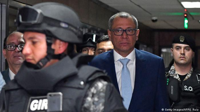 Jorge Glas on his way to the court room