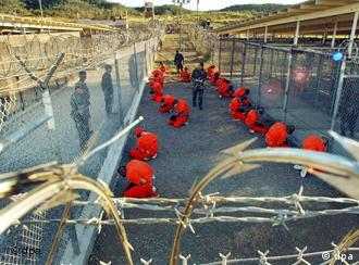 Prisoners at Guantanamo kneel in the courtyard