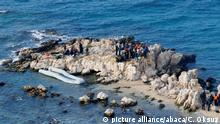 IZMIR, TURKEY - DECEMBER 14: : Refugees are seen stranded on a small rocky islet in the Aegean Sea in offshore Dikili, Izmir, Turkey on December 14, 2017. The refugees, including women and children, were trying to reach Greek Islands when an inflatable boat carrying them got stuck at the small islet near Dikili district of Izmir, according to a statement from the Turkish Coast Guard. The coast guard teams airlifted four children, while the others were transferred to safety in boats. Cem Oksuz / Anadolu Agency |