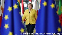 German Chancellor Angela Merkel arrives for an EU summit at the Europa building in Brussels on Thursday, Dec. 14, 2017. European Union leaders are gathering in Brussels and are set to move Brexit talks into a new phase as pressure mounts on Prime Minister Theresa May over her plans to take Britain out of the 28-nation bloc. (AP Photo/Olivier Matthys)