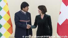 Swiss President Doris Leuthard, right, welcomes Evo Morales Ayma, President of Bolivia, to an official working visit on Thursday, December 14, 2017 in Bern, Switzerland. (KEYSTONE/Alessandro della Valle)  