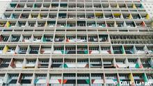 a highrise building with colorful balconies