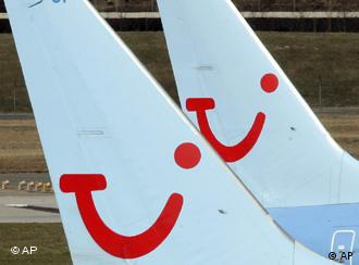 Two planes with the TUI symbol on the tails