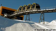 Stoos ski resort with four barrel-shaped carriages on the new route (Reuters/A. Wiegmann)
