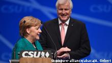 Merkel and Seehofer at the CSU party conference (picture-alliance/abaca/A. Gebert)