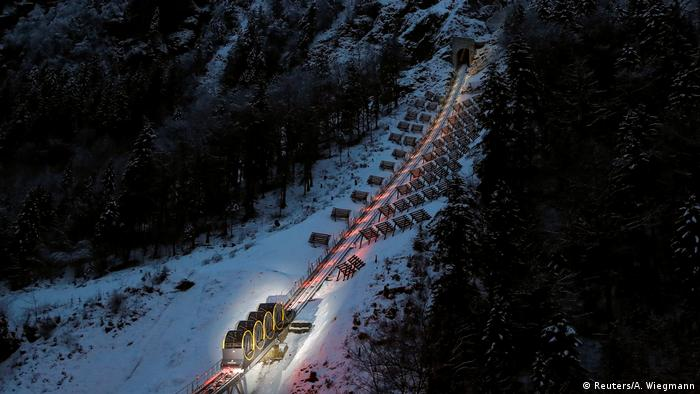 Barrel-shaped carriages of a new funicular line in Stoos, Switzerland (Reuters/A. Wiegmann)