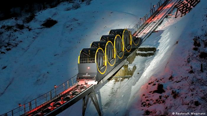 Barrel-shaped carriages of a new funicular line in Stoos, Switzerland