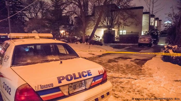A Toronto police car stands in front of the Sherman's snow-covered mansion, which was sealed-off by yellow police tape.
