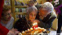 epa02989321 Ana Vela Rubio (C), a dressmaker who was born in Cordoba in 1901 and has lived in Catalonia in the last years, is caressed by her son Juan (R) and her daughter Ana (L), during a celebration at her residential home to commemorate her 110th birthday in Barcelona, Spain, 02 November 2011. Ana Vela Rubio, is the oldest person in Catalonia and one of the three oldest people in Spain. EPA/ALEJANDRO GARCIA +++(c) dpa - Bildfunk+++ |