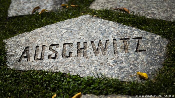 The word Auschwitz on a stone at a memorial to the murdered Roma and Sinti in Berlin