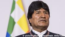 Evo Morales Ayma, President of Bolivia, on an official working visit, speaks to the media in front of the flag of the indigenous peoples of Bolivia, on Thursday, December 14, 2017 in Bern, Switzerland. (KEYSTONE/Alessandro della Valle)  