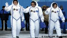 Three astronauts in space suits prepare for takeoff in Kazakhstan (Reuters/M. Shipenkov)