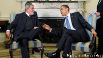 U.S. President Barack Obama (R) talks with President of Brazil Luiz Inacio Lula da Silva (L) during their meeting at the Oval Office in the White House, Washington, DC, USA, on 14 March 2009.