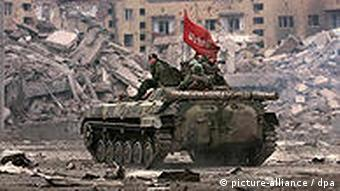 Russian soldiers patrol the streets of the destroyed Chechen capital Grozny