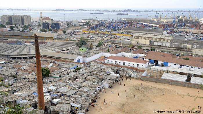 Angola's capital Luanda's harbour with a shanty town in the foreground