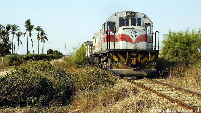 A train manages to run on the damaged railway line outside Benguela