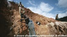 GOLD MINER AT WORK at strip mine Manica, Mozambique, south eastern Africa |