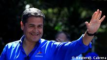 Honduras President and National Party candidate Juan Orlando Hernandez gestures during his closing campaign rally ahead of the upcoming presidential election, in Tegucigalpa, Honduras November 19, 2017. REUTERS/Jorge Cabrera