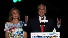 Chilean presidential candidate Sebastian Pinera (right), next to his wife Cecilia Morel (Getty Images/AFP/M. Bernetti)
