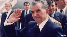 ROMANIA'S LEADER NICOLAE CEAUSESCU WAVES TO THE CROWDS AS HE RECEIVES SOVIET LEADER MIKHAIL GORBACHEV AT BUCHAREST AIRPORT IN MAY 1987. (AP PHOTO)**