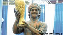 Statue of Maradona Description: Diego Maradona unveils 12-feet statue of himself in Kolkata