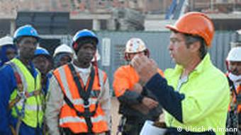 Project manager Michael Wolf briefs local workers at the construction site
