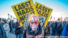 18.12.2017 *** A protester stands with stickers depicting crossed out incoming vice-chancellor of the far-right Freedom Party (FPOe) Christian Strache and incoming Austrian Chancellor of the conservative People's Party (OeVP) Sebastian Kurz during a protest near the presidential palace during the inauguration of the new Austrian government in Vienna, Austria, on December 18, 2017. Austria's far-right Freedom Party is set to round off a triumphant year for Europe's nationalists by being sworn in as part of the Alpine country's new government. / AFP PHOTO / JOE KLAMAR (Photo credit should read JOE KLAMAR/AFP/Getty Images)