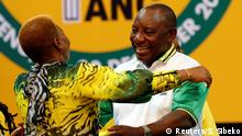 18.12.2017 *** Deputy president of South Africa Cyril Ramaphosa greets an ANC member during the 54th National Conference of the ruling African National Congress (ANC) at the Nasrec Expo Centre in Johannesburg, South Africa December 18, 2017. REUTERS/Siphiwe Sibeko