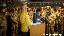 18.12.2017 *** German Defence Minister Ursula von der Leyen (2ndR) speaks during the Christmas market at Camp Marmal in Mazar-i-Sharif, northern Afghanistan, during a visit of soldiers on December 18, 2017. Von der Leyen is staying in Afghanistan for the traditional troops visit before Christmas of the German soldiers deployed there. / AFP PHOTO / POOL / Michael Kappeler (Photo credit should read MICHAEL KAPPELER/AFP/Getty Images)
