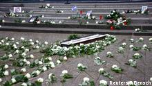 The flowers and candles are seen at the memorial at the site of last year's truck attack in a Christmas market, which killed 12 people and injured many others, at Breitscheidplatz square in Berlin, Germany December 19, 2017. REUTERS/Fabrizio Bensch