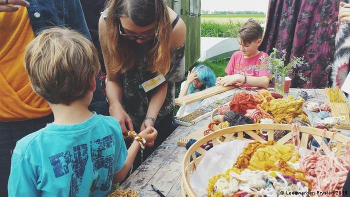 Kids creating sustainable artworks