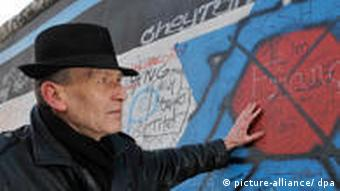 Günther Schaefer with his 'Vaterland' painting at the East Side Gallery