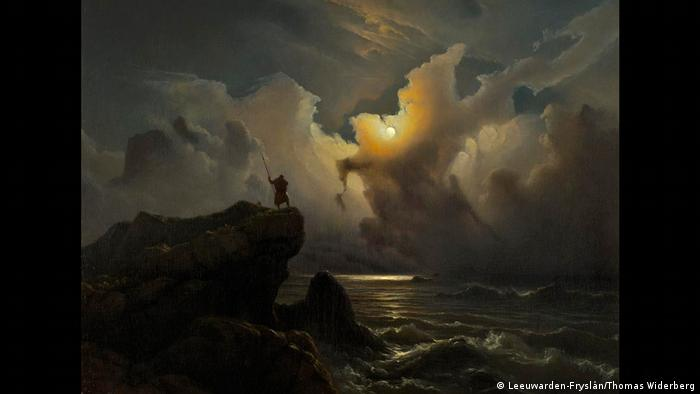 Painting by Knud Baade with sea and a man standing on a rocky cliff (Leeuwarden-Fryslân/Thomas Widerberg)