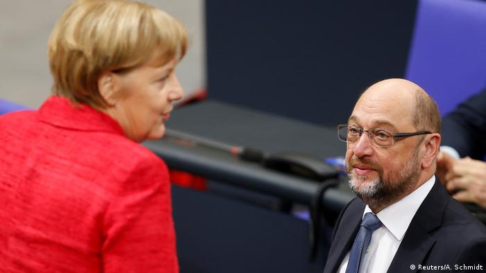 German Chancellor Angela Merkel and SPD Chairman Martin Schulz in Germany's parliament, the Bundestag (Reuters/A. Schmidt)