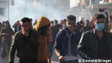 Kurdish protesters run away from tear gaz during a rally against the Kurdistan Regional Government (KRG) in Sulaimaniyah, Iraq December 18, 2017. REUTERS/Stringer. NO RESALES. NO ARCHIVES