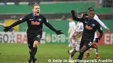 PADERBORN, GERMANY - DECEMBER 19: Ben Zolinski of Paderborn celebrates scoring his goal with Christopher Antwi-Adjej during the DFB Cup match between SC Paderborn and FC Ingolstadt at Benteler Arena on December 19, 2017 in Paderborn, Germany. (Photo by Stuart Franklin/Bongarts/Getty Images)