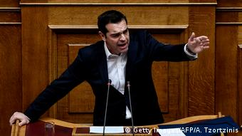Greek Prime Minister Alexis Tsipras gestures as he delivers a speech during a parliamentary session in Athens