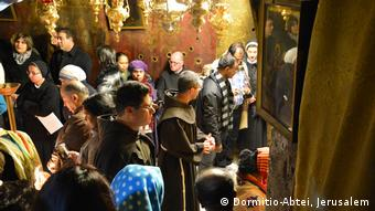 Christmas one year ago: pilgrims at a Dormition Abbey event in the Church of the Nativity (Dormitio-Abtei, Jerusalem)