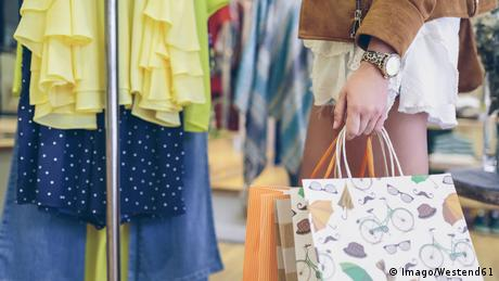 Close-up of woman holding shopping bags in a boutique