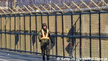 A South Korean soldier walks along a military fence on the road leading to North Korea's Kaesong joint industrial complex at a military checkpoint in the border city of Paju near the Demilitarized zone dividing the two Koreas on January 8, 2016. South Korea said on January 7 it would resume propaganda broadcasts into North Korea, a tactic that prompted Pyongyang to threaten military strikes when it was last employed during a cross-border crisis last year. AFP PHOTO / JUNG YEON-JE / AFP / JUNG YEON-JE (Photo credit should read JUNG YEON-JE/AFP/Getty Images)