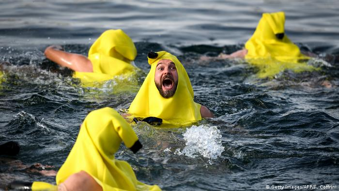 People swimming in banana costumes (Getty Images/AFP/F. Coffrini)